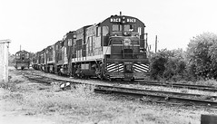 Seaboard Coast Line locomotives are seen waiting for their next assignment at an unknown location, possibly in Tampa, but definitely in Florida, mid 1970's - 3 (alcomike43) Tags: old blackandwhite bw classic yard vintage ties switch photo diesel tracks engine historic negative photograph rails locomotive siding ge spikes ballast generalelectric switcher rightofway scl turnout alco tampaflorida targets seaboardcoastline railroadyard emd roadbed diesellocomotive deiselengine gp30 u18b tieplates anglebars deiselelectriclocomotive manualswitchstand readytracks conventionaljointedsectionrails locomotivestoragetracks