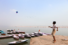 Kite. Varanasi, India (Marji Lang Photography) Tags: banaras benares bnars canoneos5dmarkii ef247028l ganga gange ganges gangesriver gaudolia godaulia gowdolia hindu india indian indiansubcontinent kashi k marjilang republicofindia travelanddocumentaryphotography travelphotography uttarpradesh varanasi vras alone atmosphere boat boats boy cerfvolant child childhood color composition daylight documentary enjoying fleuve fun ghats holyganges holycity horizontal kid kite kiteplay moment oldvaranasi oldcity oldtown one oneperson play playing river roamingboat scene sky sport travel young youth