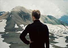 Wanderer above the sea of rocks and snow (Catherine Lembl) Tags: man mountains view wanderer analog midformat mamiya645super film sooc 120mm switzerland swiss berge berner oberland bernese alpen alps swissalps