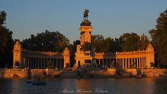 Lights and shadows in El Retiro. (Alejandro Hernández Valbuena) Tags: architecture lake europe historical boats tourism blue green spanish tourist summer statue ancient culture landscape sky spring construction city madrid monument water european park vacation garden retiro urban people travel art building antique landmark historic sun spain ship ships sunset