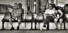 Bus Stop Boredom (Jon Scherff) Tags: busstop people street streetphotography candid sepia nikond810 sitting waiting peoplewatching sit seated