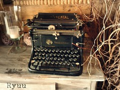 old typing machine (Ryuu竜) Tags: typingmachine wooden table glass display candle floral drytwigs composition ikebana machine warmtones indoors decoration interiourdesign desk oldstuff oldstyle junk vintage oldschool retro buttons keys keyboard writingmachine continental
