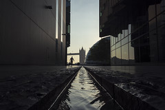 The Heist (andre adams) Tags: sunrise reflections water geometry urban architecture silhouette running glass bag highrise thief frame cinematic ontherun backlit heist london uk unitedkingdom towerbridge cityhall