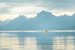 Afloat (Lisa Bell Jamison) Tags: lakemcdonald glaciernationalpark gnp montana lake blue boat yellow water mountains