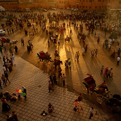 Morocco - Marrakech - Jemaa el-Fnaa - Sunset scene 02 sq (Darrell Godliman) Tags: africa travel light sunset people copyright view terrace northafrica squares balcony wideangle busy morocco squareformat maroc vista marrakech marrakesh viewpoint sq allrightsreserved chaotic settingsun travelphotography bustling bsquare jemaaelfnaa innamoramento dgphotos darrellgodliman wwwdgphotoscouk dgodliman moroccomarrakechjemaaelfnaasunsetscene02sqdsc5425 wwwfacebookcomdsgphotos