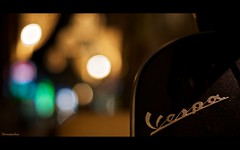Vespa bokeh (Caropaulus) Tags: night 50mm lights vespa bokeh nuit lumieres