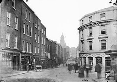 Shop Street, Drogheda, same day? (National Library of Ireland on The Commons) Tags: bridge ireland 19thcentury ale bakery painter ladder louth barbers drogheda pawnbrokers glassnegative signwriter leinster shopstreet barberspole 0855 robertfrench williamlawrence nationallibraryofireland jamescurtis towncouncillor lawrencecollection dutchbilly haircuttingrooms basstenguineaale youngerco youngersindiapaleale eohanlon whitworthmonument boroughtreasurer webstersbakery