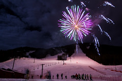 Fireworks Over Snow King Ski Resort (Free Roaming Photography) Tags: winter light usa mountain snow mountains west colorful fireworks explosion jackson celebration event skiresort skilift northamerica wyoming festivity festivities jacksonhole snowking ipsssdr internationalpedigreestagestopsleddograce snowkingskiresort
