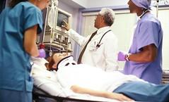 Rakesh-Pherwani-Doctor-Reading-Scope-With-Patient (Rakesh Pherwani) Tags: reading spring texas scope dr tx doctor rakesh pherwani rakeshpherwani rakeshbpherwani