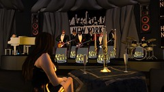 That Big Band Sound (alexandriabrangwin) Tags: alexandriabrangwin secondlife 3d cgi computer graphics virtual world new york big band sound club night brass guitars bass drums piano classy evening metallic bronze dress candles champagne glasses table