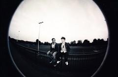 Boys on the Heath (BeefySquarms) Tags: hampsteadheath runningtrack fencehoppers 35mm fisheye bwonly filmphotography