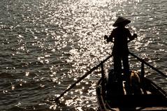 silthuette (_Maganna) Tags: silthuette fisherman man boat vietnam vietnamese sea light reflection travel