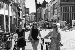 Three in a row (Dutch_Chewbacca) Tags: girl girls woman women feminine female females beauty pretty young venus brunette redhead friends bike bicycle walking city urban street life straatfotografie streetphotography vrouw vrouwen meisje meisjes sneaky stad straat nl canon 35mm bw monochrome blackandwhite blackwhite noir et blanc sexy summer hot dutch the netherlands holland shertogenbosch den bosch denbosch duketown 073 noordbrabant brabant heet zomer nederland dames people strangers human lens dlsr d550 wednesday 24 august 2016 hotpants apple macdonalds unposed unpolished raw