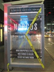 Narcos Bus Shelter Pile O Money AD - UPDATE They stole the fake money 5521 (Brechtbug) Tags: narcos bus shelter pile o money ad tv show stop with piles slightly singed real fake or is it 2016 nyc image taken 09172016 midtown manhattan new york city 49th street 7th ave st avenue moola bogus update they stole