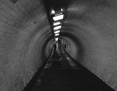 Down in the tunnel, London Town (pommypaul) Tags: england greenwich london blackwhite creepy tunnel damp commuter goinghome