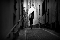 Walking the streets of Stockholm (*Kicki*) Tags: a900 stockholm sweden gamlastan oldtown person silhouette street houses walking 100mm alley prstgatan