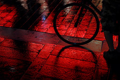 Red light zone (Cedpics) Tags: city france wet bike wheel night floor noel citylights toulouse redlight nuit vlo christmastime roue non pav lumiererouge fujixpro1 fujinonxf60mmf24