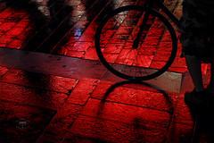 Red light zone (Cedpics) Tags: city france wet bike wheel night floor noel citylights toulouse redlight nuit vélo christmastime roue néon pavé lumiererouge fujixpro1 fujinonxf60mmf24