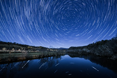Stars on the James (jon_beard) Tags: sky mountains reflection water night river dark stars lights trails jamesriver