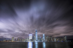 By Night (Tim Drivas) Tags: city nyc newyorkcity longexposure winter skyline night clouds reflections lights downtown manhattan worldtradecenter financialdistrict hudsonriver wtc gothamist hdr exchangeplace skyscapers goldmansachs freedomtower cloudmovement 1wtc 4wtc
