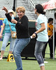 Guadalupe Rodriguez (left), Jennifer Lopez's mother, dances on the football pitch at the Pre
