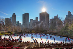 Winter skating in central park (Andrew 73) Tags: park new york nyc blue winter sky sun ice skyscraper canon thomas skating central andrew 5dmark3