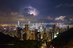 It thunders in the mountains behind the city ... (jazzpic) Tags: city skyline night hongkong nikon peak thunderstorm lightning kowloon thunder d3 nightfall victoriaharbour 1424mmf28gplacesadmiraltyasiacentralchinaeveningharbourheavycloudshongkongkowloonlightningskylinethunderstormwanchaithepeakhongkonghkg