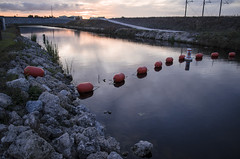 Levee at Sunset (TatiBlanch) Tags: sunset reflection water canal everglades