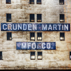 Crunden Martin Manufacturing Company - Skybridge (photosisee) Tags: old blue windows light building texture water glass wall architecture backlight canon frames rust peeling paint glow decay grunge bricks letters stlouis symmetry warehouse abandon age missouri damage backlit 2470 5dmarkiii crudenmartinmfgco