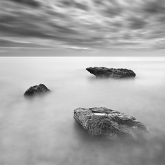 Three... (DavidFrutos) Tags: longexposure sea bw costa seascape beach water monochrome rock clouds sunrise square landscape m