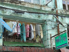 Clothes and Grunge (mikecogh) Tags: sign yangon grunge clothes cables wires hanging grime washing satellitedish rangoon