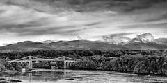 The Menai Bridge (Anthony Owen-Jones) Tags: uk blackandwhite bw white black art water monochrome wales clouds canon landscape eos rebel mono coast landscapes photo kiss europe unitedkingdom north picture photograph bnw conwy t3i x5 anglesey northwales sep2 600d menaibridge takenwith rebelt3i kissx5 anthonyowenjonescom