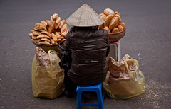 French Baguette Vendor in The Old Quarter - Hanoi, Vietnam (ChrisGoldNY) Tags: vietnam southeastasia asia asian hanoi chrisgoldny chrisgold chrisgoldberg chrisgoldphotos chrisgoldphoto posters poster forsale albumcover albumcovers bookcover bookcovers city urban travel viajes baguettes bread conical hats vietnamese consumerist eater oldquarter vender streetfood streetscenes streets frombehind people indochina northvietnam viet nam lonelyplanet jaunted gridskipper vn challengefactory challengewinners unanimous