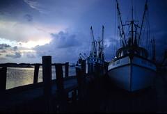Shrimp fleet at dusk: Key West, Florida (State Library and Archives of Florida) Tags: sunset water clouds docks islands florida dusk keywest 1970s shrimpboats monroecounty standardoil fishingvessels seafoodindustry statelibraryandarchivesofflorida dalemmcdonaldcollection misscubieshrimpboat