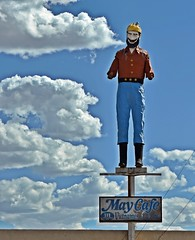 Primary Paul (Jo Zimny) Tags: theflickrlounge primarycolours paulbunyan statue wood hat yellow shirt red pants blue boots black perch maycafe sky clouds white fluffy mustache face