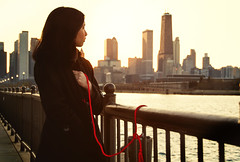 Love Chicago (Kevin Casey Fleming) Tags: city chicago meaningful water woman environment expression exposure quality bright sunset orange girl girlfriend rope symbolic building leadinglines lines leading landscape portrait pretty people person interesting imagination illinois usa young looking coat sun sunlight beautiful nikon colorful composition explore backlit red downtown emotive emotion heart close