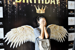 Reluctant angel (Roving I) Tags: reluctant shy angels wings hiding hands girls bags crowns birthdays karaokebars nightlife danang vietnam trishngo