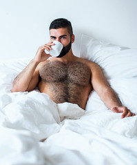 1241 (rrttrrtt555) Tags: hair hairy chest muscles shoulders arms beard bed bedroom sheets pillow comforter coffee cup mug drink attitude masculine eyes lounge stare
