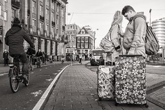 just arrived in Amsterdam (Gerard Koopen) Tags: nederland netherlands amsterdam city tourists suitcase luggage people boy girl bw blackandwhite candid straatfotografie streetphotography straat street fujifilm fuji x100t 2015 gerardkoopen o