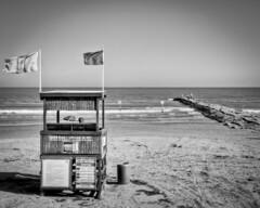 Galveston-Beach (Ray Devlin) Tags: texas lonestarstate gulfofmexico coastaltexas coastal usa america shoreline sea black white blackandwhite beach galveston seawall lifeguard station rock jetty groyne