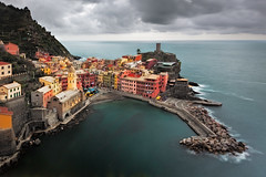 A Town on the Coast (Jared Ropelato) Tags: ocean longexposure sea sky italy color nature water clouds canon coast town italian day waves cloudy crash hike cliffs trail filter cinqueterre wilderness lands lanscape foreground graduated density neutral gnd singhray 5dmkii jaredropelato ropelatophotography