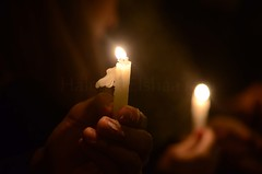 wax melting on the hands of the participants in the vigil (Haleem Elsha3rani  ) Tags: sadness candles egypt cairo grief candlelightvigil miu
