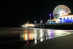 merry go round (katebartnik) Tags: ocean california light reflection beach colors wheel lights pier sand long exposure santamonica merrygoround