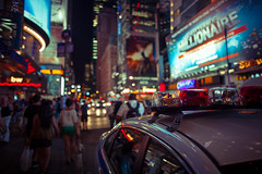 City of Fireflies (Standard Deluxe) Tags: street newyorkcity light building car night streetlight automobile neon manhattan timessquare 24mm passerby theatredistrict 24l canonef24mmf14liiusm