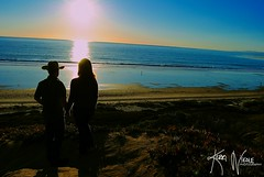 A Hand to Hold (KerriNikolePhotography) Tags: ocean california boy portrait sun green love girl silhouette santabarbara engagement sweater couple purple country jeans holdinghands backlit nikkor engaged cowboyhat goleta zoomlens buttondown ellwoodbeach ellwoodbluffs kerrinikolephotography