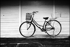 Mamachari (Eric Flexyourhead) Tags: city urban bw detail bike bicycle japan blackwhite  osaka kita kansai jitensha fragment kitaku  mamachari   osakashi  grainyfilm artfilter   charinko olympusep1 panasoniclumix20mmf17