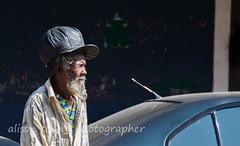 Jamaica-Falmouth-6025 (alison.toon) Tags: street portrait people copyright hat dreadlocks town photographer streetscene jamaica dreads jamaican falmouth rasta rastafarian crossingstreet townlife alisontoon
