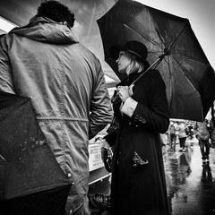 Walkies in the Rain (Fuji and I) Tags: bricklane london street streetart rain walkies blackandwhite umbrellas monochrome alexarnaoudov