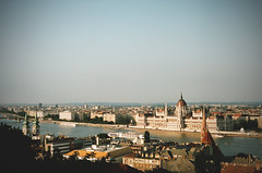 classic (Kathleen Vtr) Tags: blue light sunset summer sky panorama holiday hot beautiful sunshine skyline analog 35mm river landscape gold cityscape view rooftops outdoor budapest panoramic explore canonae1 monuments danube discover donau degrees goldenlight filmphototgraphy kodakportra citytravel