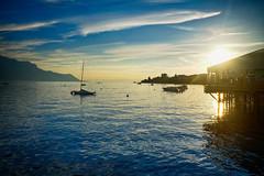 Sunset in Montreux, Switzerland (` Toshio ') Tags: toshio montreux switzerland montreuxjazzfestival jazzfestival sunset lake lakegeneva lacleman water sailboat boat clouds swiss suisse europe european fujixe2 xe2 reflection